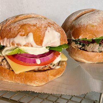 Fully assembled Feta Ranch Burgers with brioche bun