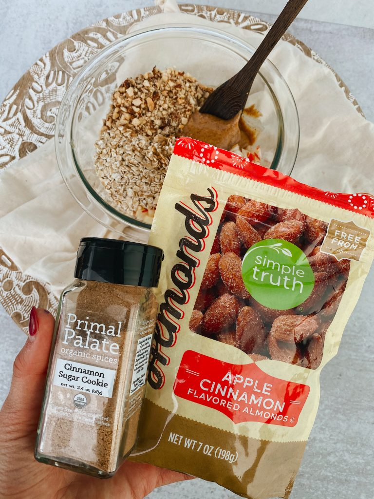 hand holding cinnamon sugar and package of recommend nuts to use