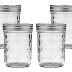 4 glass mason jars with white background