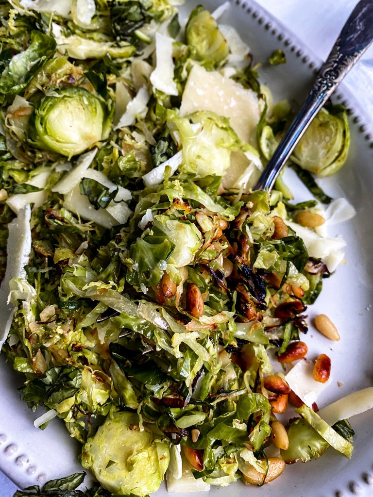 45 degree close up of fork dishing out brussel sprout salad