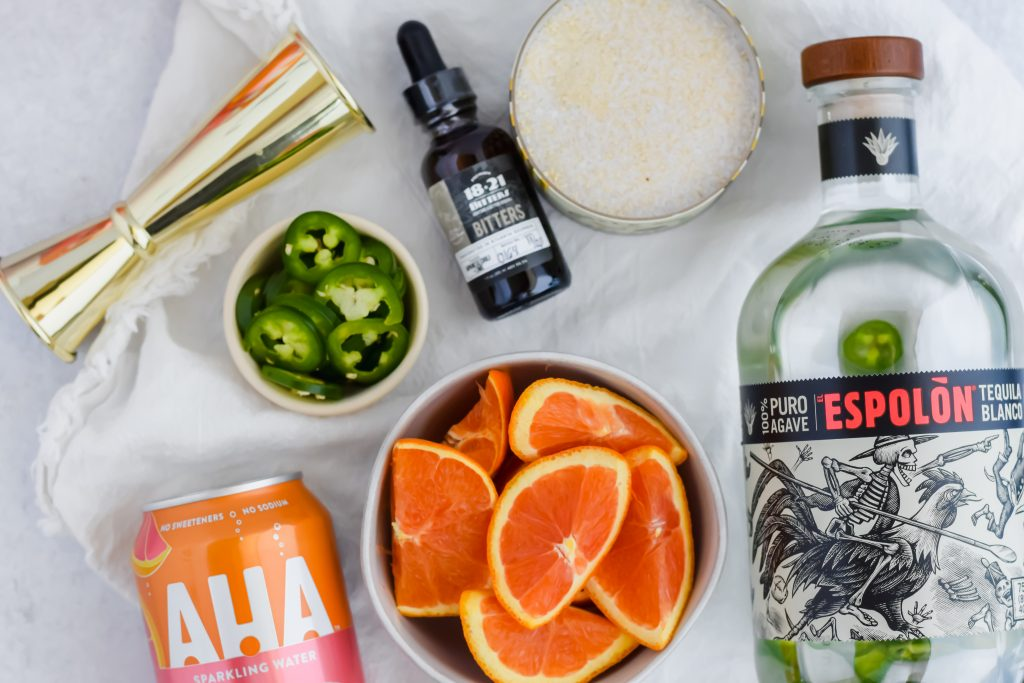 Flat lay of Spicy Orange and Jalapeño Margarita ingredients