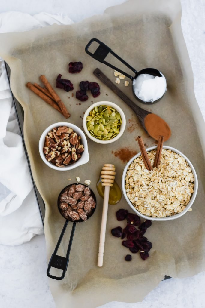 homemade granola ingredients in bowls