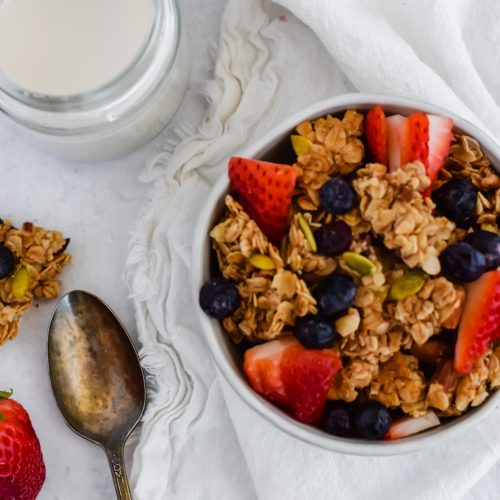 bowl of granola with fresh strawberries and blueberries