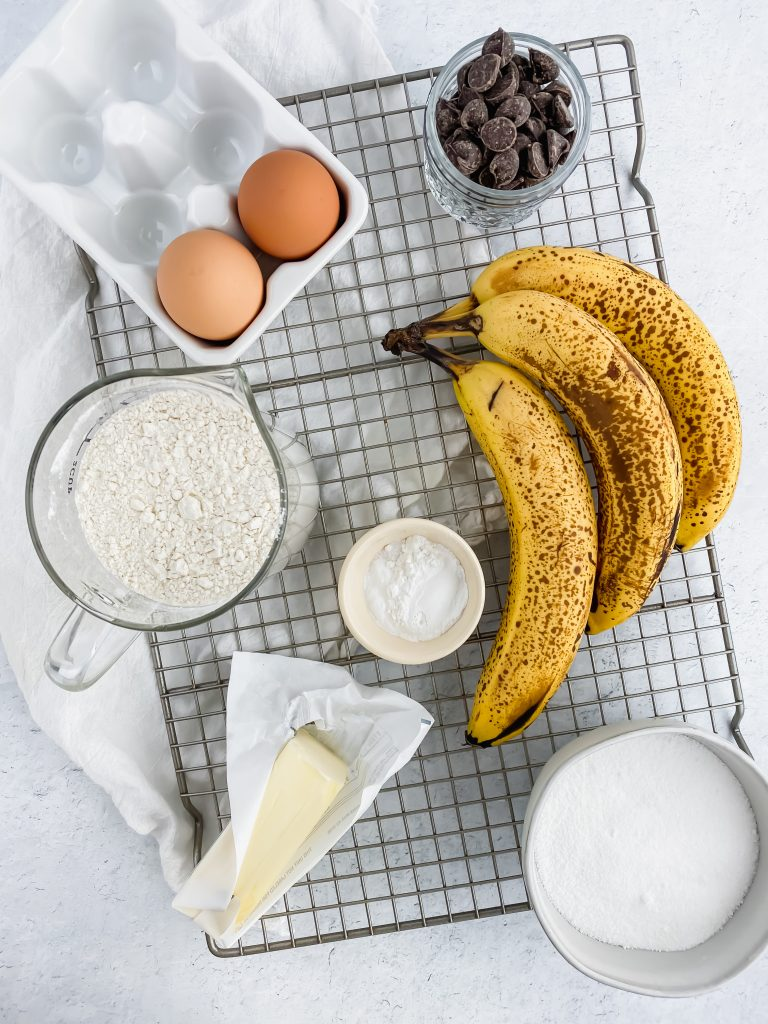flat lay of ingredients for banana bread on wire rack