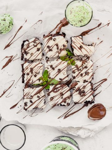 Mint Brownies with Cream Cheese Frosting drizzled with chocolate and topped with mint leaves