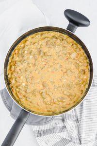Spicy Sausage Hummus Pasta cooking in pan