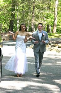 girl and boy walking to prom on wooden path