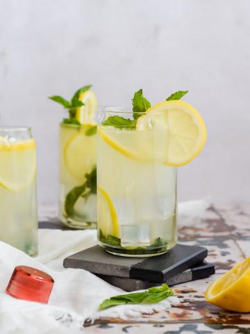 Three Skinny Lemonade Mojitos, one resting on two grey and black coasters