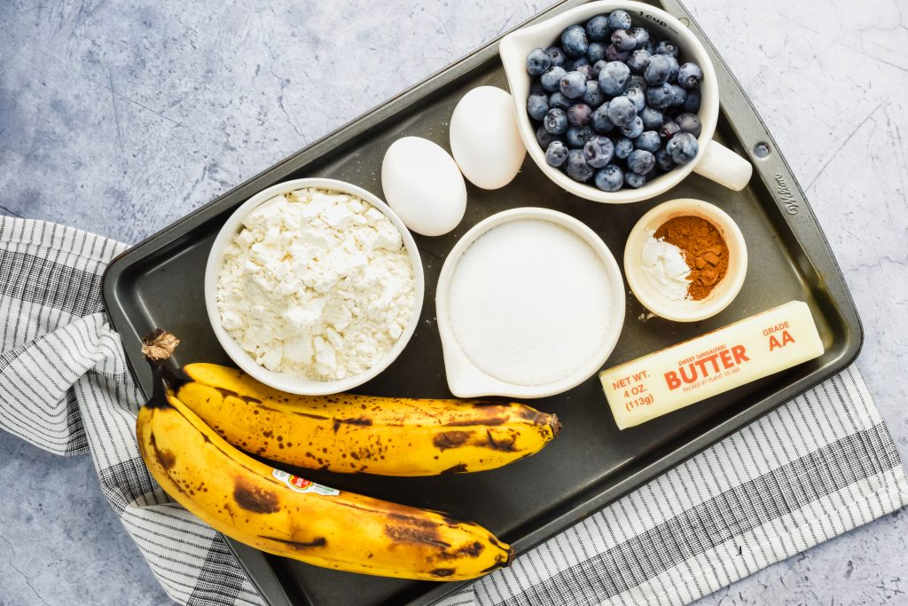 Blueberry Banana Bread ingredients on a sheet pan