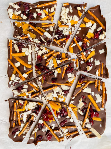 Cracked chocolate bark with pretzels, dried fruit, and coconut shavings