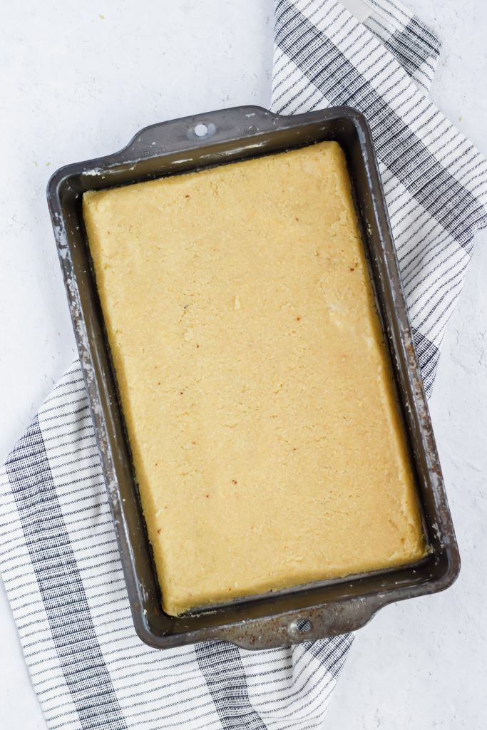 metal pan with uncooked shortbread pressed into it