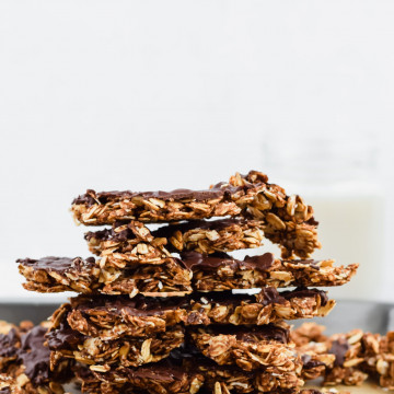 peanut butter chocolate granola clusters stacked on top of each other