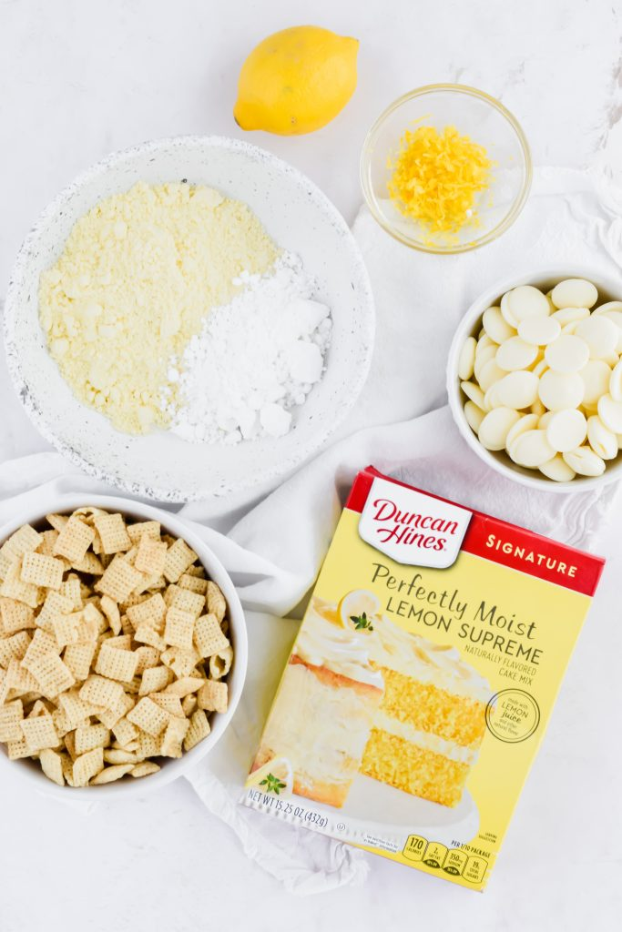 overlay of ingredients for lemon puppy chow on concrete background