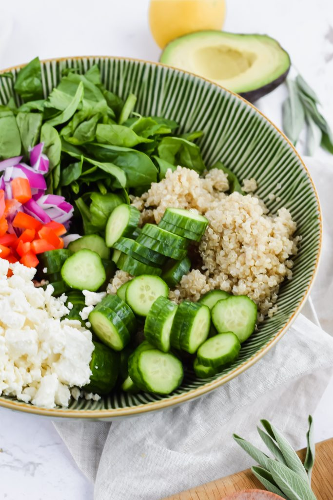 green salad bowl with all of the ingredients in it for Spinach Quinoa Salad