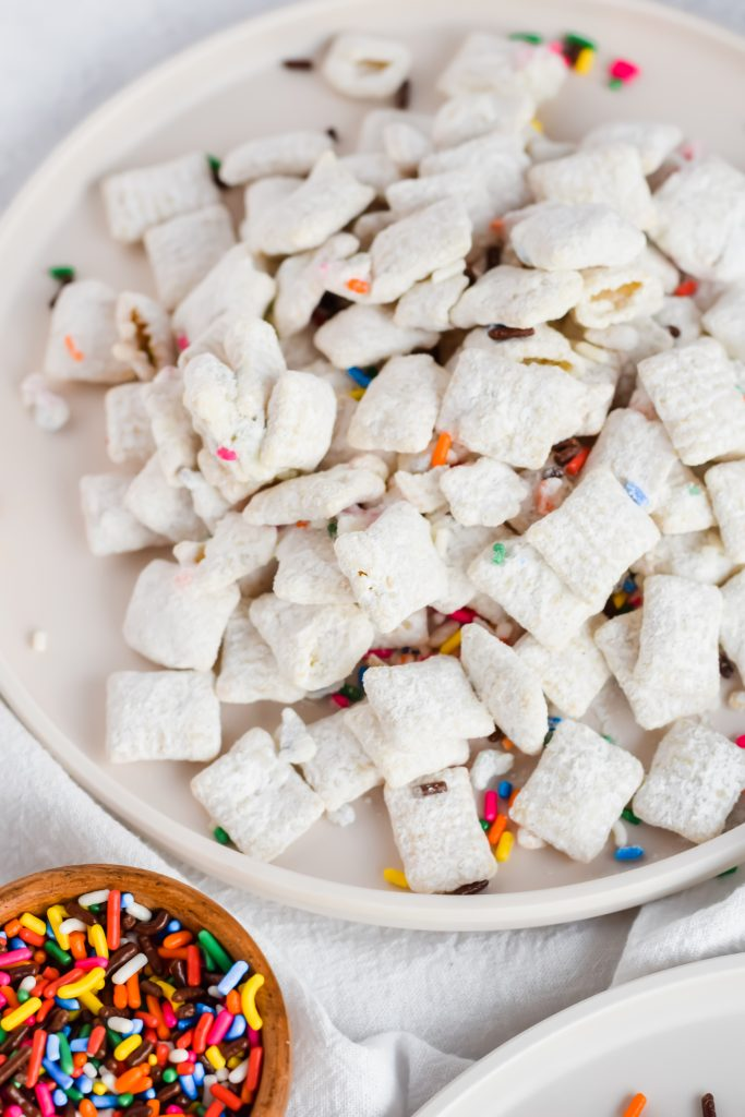 plate of funfetti puppy chow on white dish