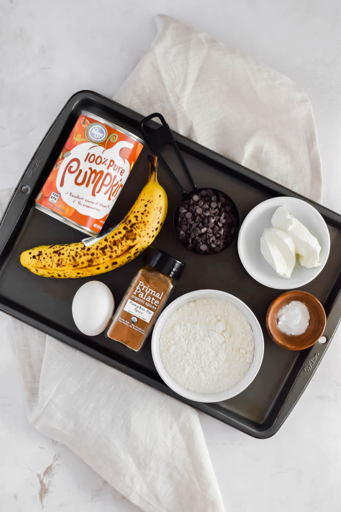 ingredients spread out on metal sheet pan on top of folded white towel background