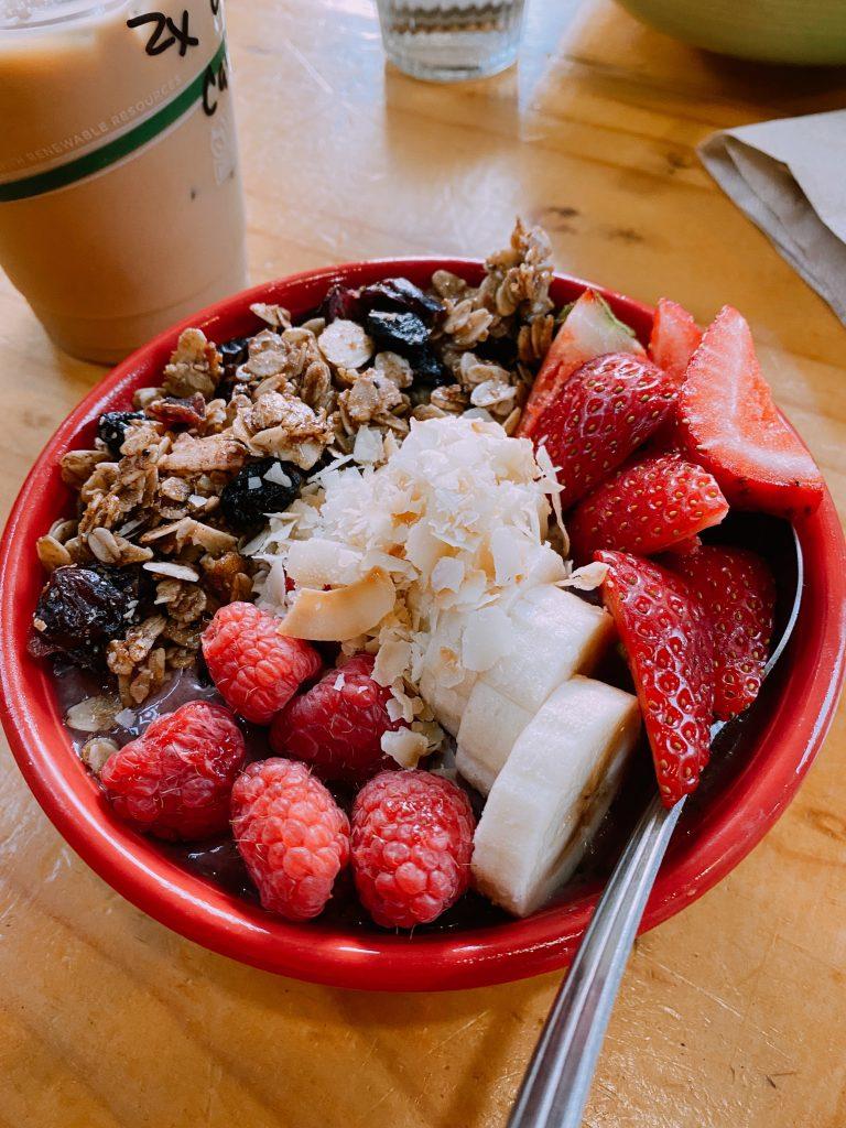 fruit bowl with strawberries, banana, and granola