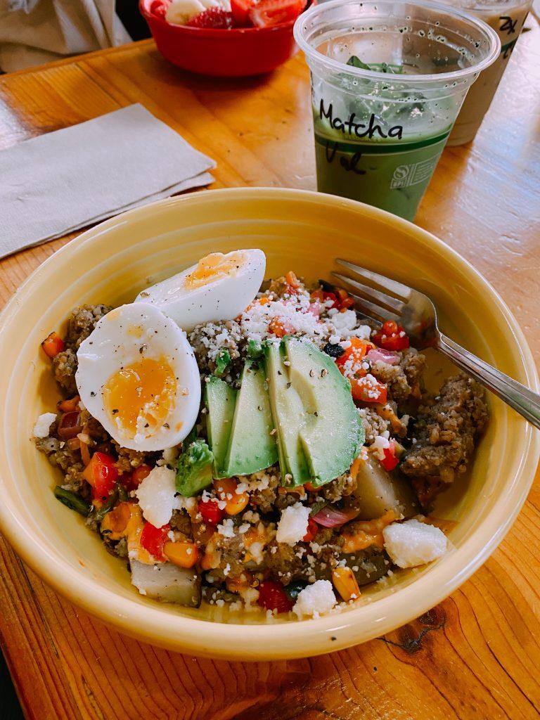 yellow bowl with quinoa, avocado, and eggs