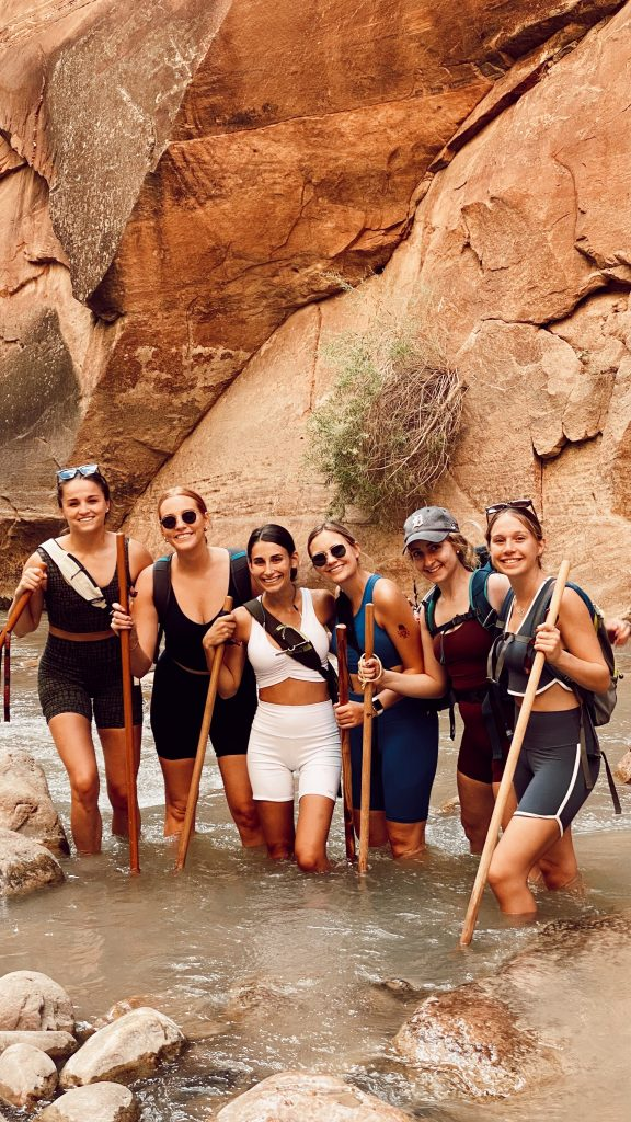 smiling bunch of six ladies in the middle of the Narrows Hike