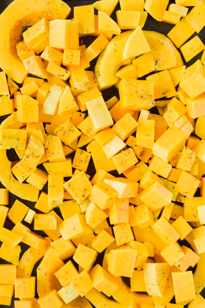 diced and cubed butternut squash on sheet pan ready to be roasted