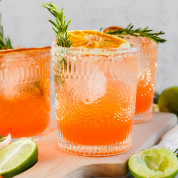 garnished Italian Margaritas with fresh rosemary and dried oranges