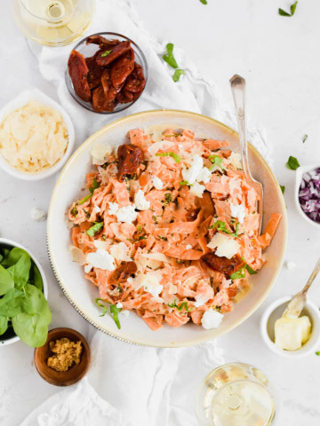 vibrant bowl of sweet potato goat cheese noodles with sundried tomatoes and basil